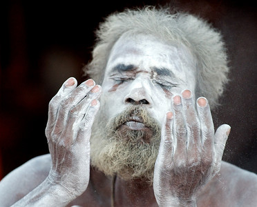 Naga Baba covering himself with ashes. Kumbh Mela 2010, Haridwar.