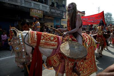 Naga Baba on horse back during procession. Kumbh Mela 2010, Haridwar.