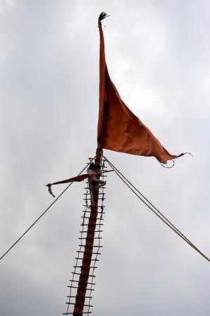 Naga Baba climbing the flag pole. Kumbh Mela 2010, Haridwar.