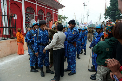 Massive amount of security getting ready to follow the procession of the Niranjani akhara. Kumbh Mela 2010, Haridwar.