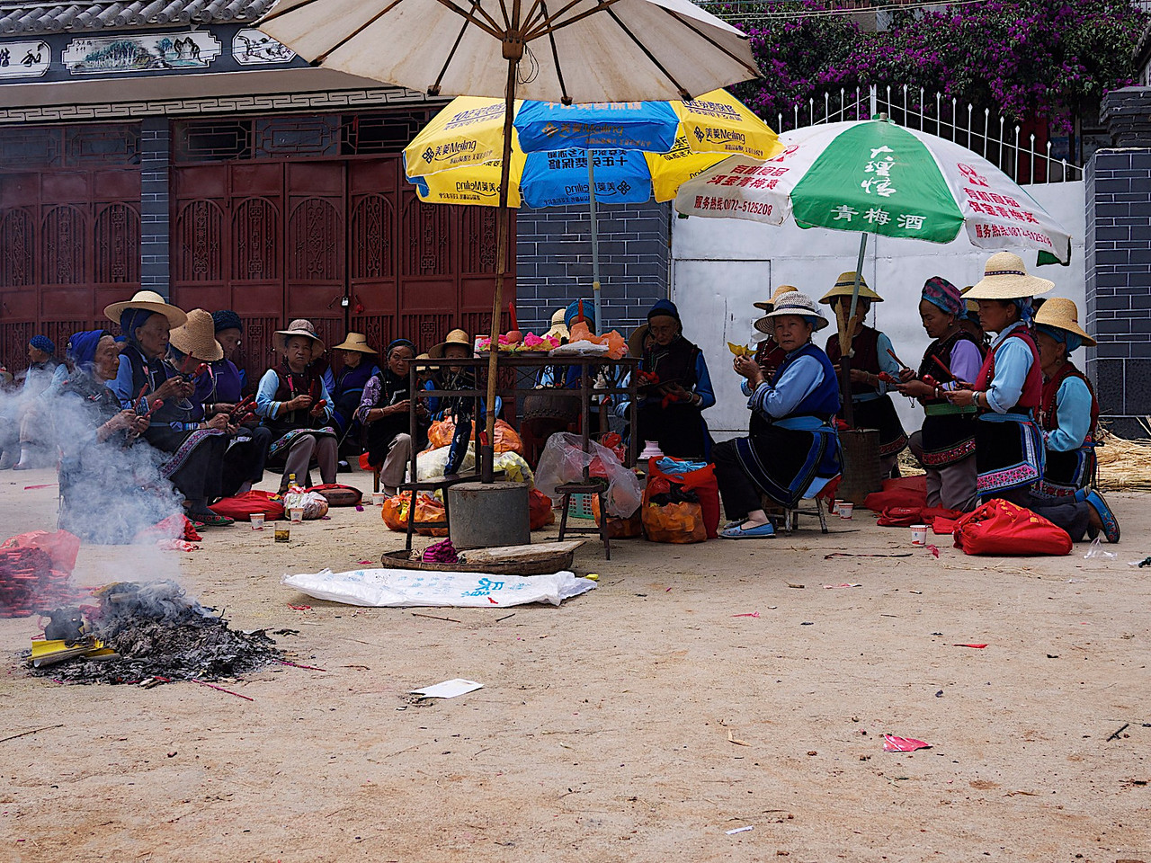 the bai women keep the tradition alive by singing all day in preparation for the evening's fire festivities