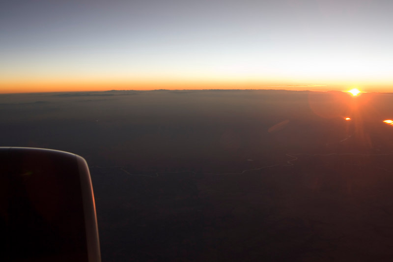 Sunrise over mountains in Afganistan on the way into Kuwait.