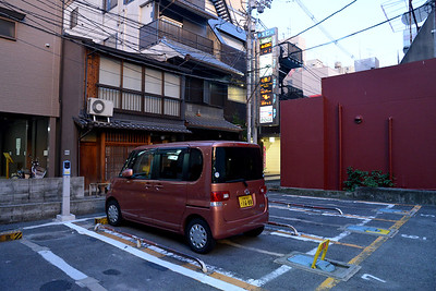 Space is limited - an interesting car park. Kyoto (京都市) is a city located in the central part of the island of Honshu, Japan. It has a population close to 1.5 million. Formerly the imperial capital of Japan for more than one thousand years, it is now the capital of Kyoto Prefecture, as well as a major part of the Kyoto-Osaka-Kobe metropolitan area. With temples, parks, bustling business districts, markets, from regal estates to the tightly-packed neighborhoods, Kyoto is one of the oldest and most famous Asian metropolises. Although ravaged by wars, fires, and earthquakes during its eleven centuries as the imperial capital, Kyoto was spared from much of the destruction of World War II. With its 2000 religious places- 1600 Buddhist temples and 400 Shinto shrines, as well as palaces, gardens and architecture intact, it is one of the best preserved cities in Japan.