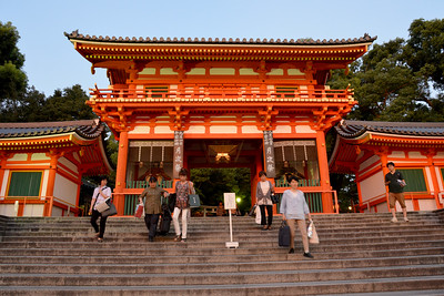 Yasaka Shrine (八坂神社), once called Gion Shrine (祇園神社), is a Shinto shrine in the Gion District of Kyoto, Japan. Situated at the east end of Shijō-dōri (Fourth Avenue), the shrine includes several buildings, including gates, a main hall and a stage. The Shrine became the object of Imperial patronage during the early Heian period. Today, in addition to hosting the Gion Matsuri, Yasaka Shrine welcomes thousands of people every New Year, for traditional Japanese New Year rituals and celebrations.  Kyoto (京都市) is a city located in the central part of the island of Honshu, Japan. It has a population close to 1.5 million. Formerly the imperial capital of Japan for more than one thousand years, it is now the capital of Kyoto Prefecture, as well as a major part of the Kyoto-Osaka-Kobe metropolitan area. With temples, parks, bustling business districts, markets, from regal estates to the tightly-packed neighborhoods, Kyoto is one of the oldest and most famous Asian metropolises. Although ravaged by wars, fires, and earthquakes during its eleven centuries as the imperial capital, Kyoto was spared from much of the destruction of World War II. With its 2000 religious places- 1600 Buddhist temples and 400 Shinto shrines, as well as palaces, gardens and architecture intact, it is one of the best preserved cities in Japan.