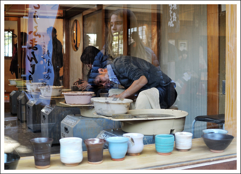 A pottery class and window reflections.