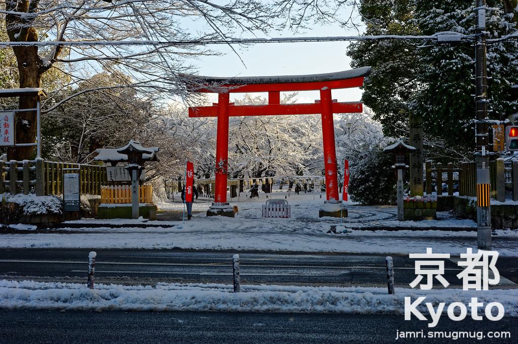 Passing Hirano Shrine on a Snowy Morning