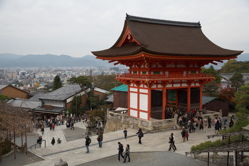 This is a look back at the gate along with modern Kyoto.