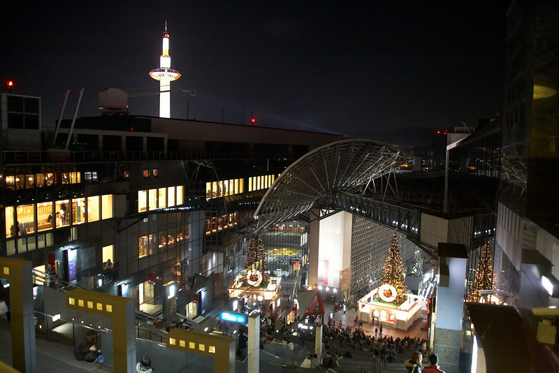 The Kyoto Station is a gigantic train station and shopping mall. This shot was taken from one of the upper open air floors. You can see that the Christmas decorations are in place. The nearby Kyoto Tower can be seen in the background.