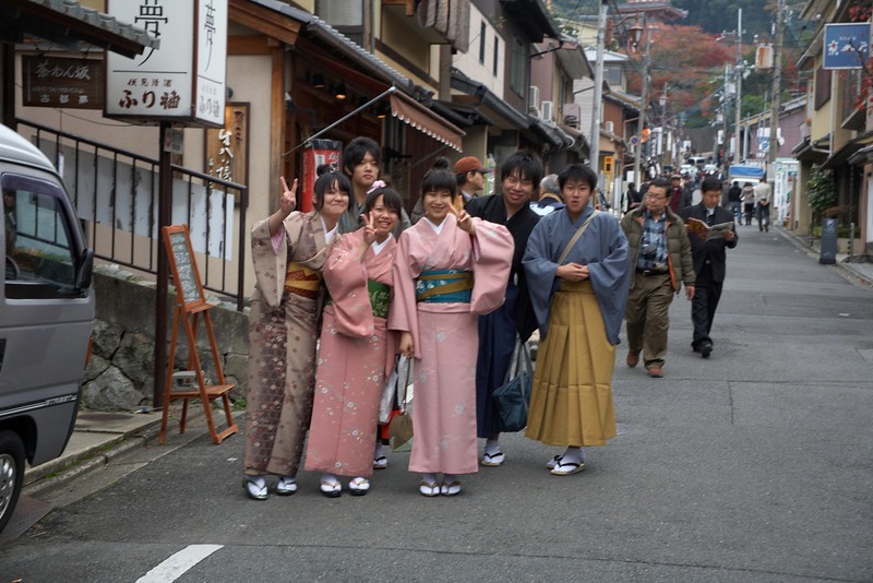 Japanese tourists coming back from Kiyomizu-dera Temple. They really seem to enjoy having their photo taken by other tourists.