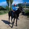 Kyrgyz boy on horseback