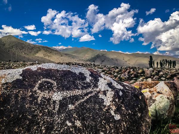 draing and mountain backdrop at Cholpon-Ata Petroglyphs Kyrgyzstan