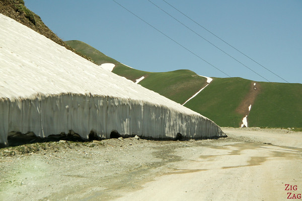 Snow on side of road Kyrgyzstan 1