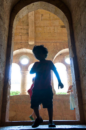 Jaden silhouetted by the beautiful arched windows.  The play with light throughout this medieval complex was just beautiful.