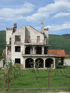 A burned out luxury villa complete with bullet holes. Unfortunatly there were quite a few houses like this