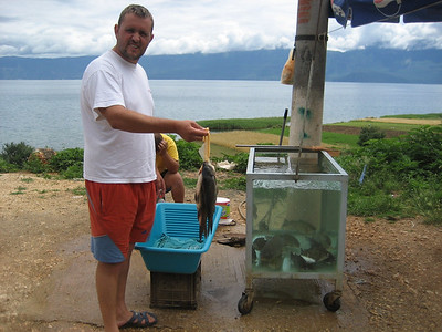 They were selling Fresh Fish all the way up the lake. The ones alive in the tank could not be much fresher !!!! Lake Ohrid, Albania