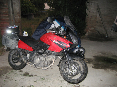 About 2 hours after the last picture was taken  just outside Modena i had a massive thunderstorm. I could not find a campsite, so i free camped in this old barn. Look at the state of the bike !!!!! the rain only lasted for a few hours but it caused a lot of flooding and mess