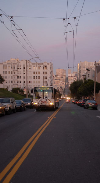 An electric bus climbing a steep hill.