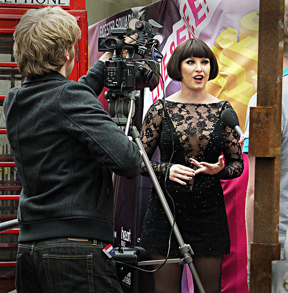"""EMMA BARTON, WHO PLAYS ROXIE HART IN THE LONDON STAGE VERSION OF """"CHICAGO"""" BEING INTERVIEWED BY THE BRITISH PRESS."""
