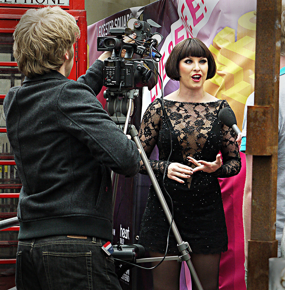 "EMMA BARTON, WHO PLAYS ROXIE HART IN THE LONDON STAGE VERSION OF ""CHICAGO"" BEING INTERVIEWED BY THE BRITISH PRESS."