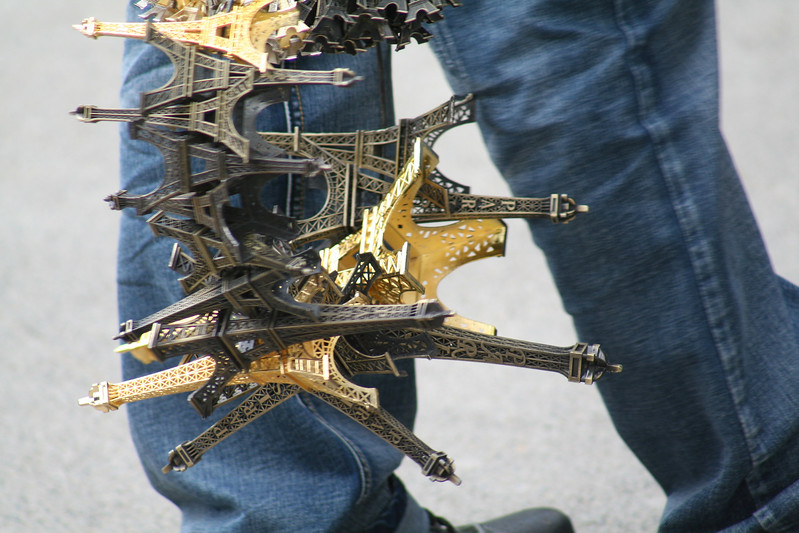 Beware the guys with the giant key ring full of Eiffel Towers...