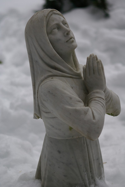 Statue of mary praying in Holliston in feet of snow.
