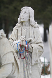 Rosary Beads left on Statue for prayers