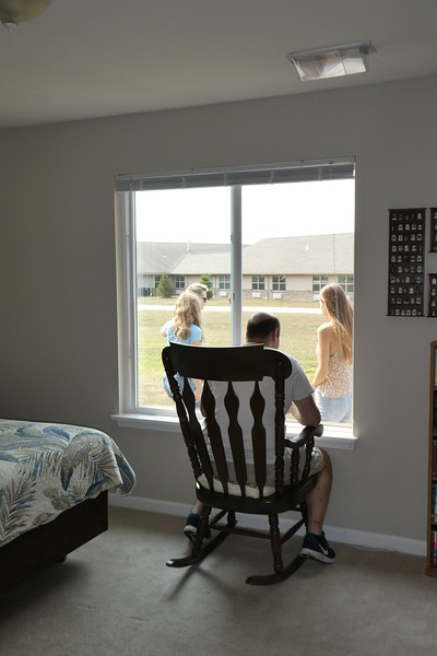 Diane's brother, Dave, watching us play croquet out the bedroom window.