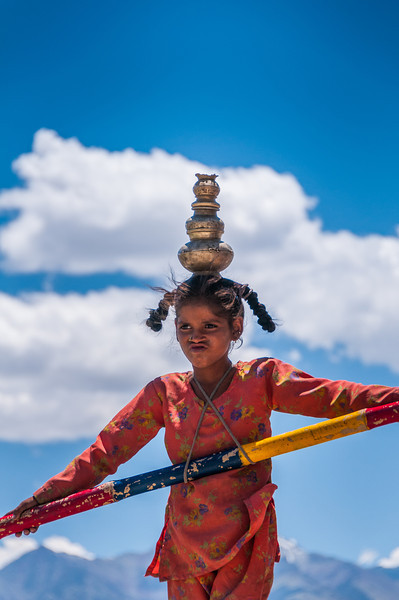 A young tightrope walker earns a living for her family at Phyang Gompa festival, Ladakh