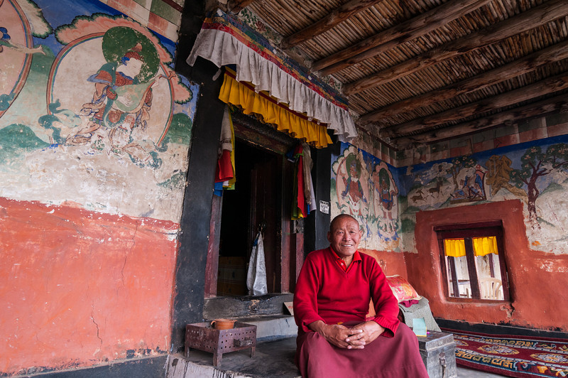 A proud monk watches over Soma Gompa in the Leh Palace complex