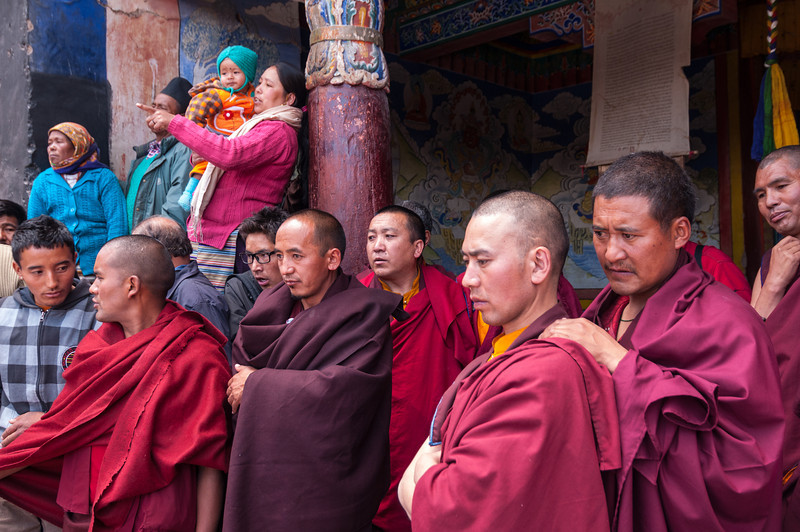 Monks look on as their protege's perform in the festival at Hemmis