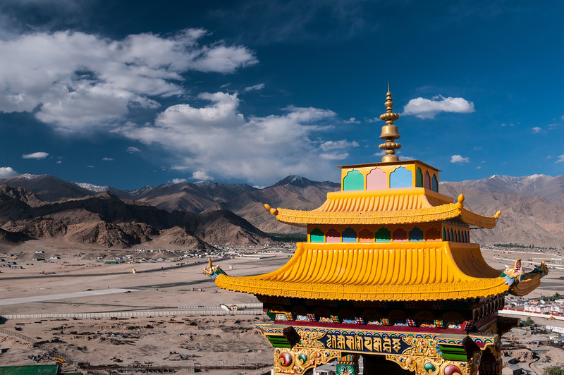 Spitok Gompa's prayer wheel building looks out across Leh airport and the Ladakh Range beyond