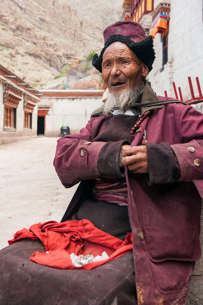An old monk sells crystals at Hemmis