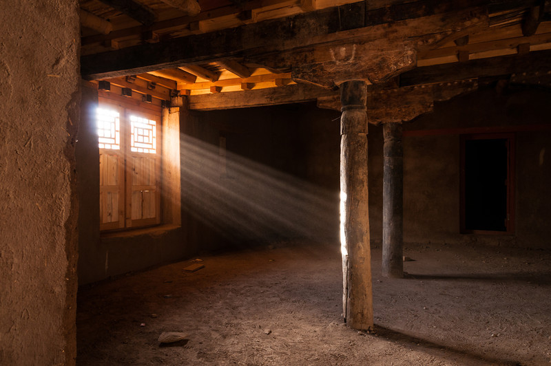 A rare shaft of light penetrates the nine storey Leh Palace