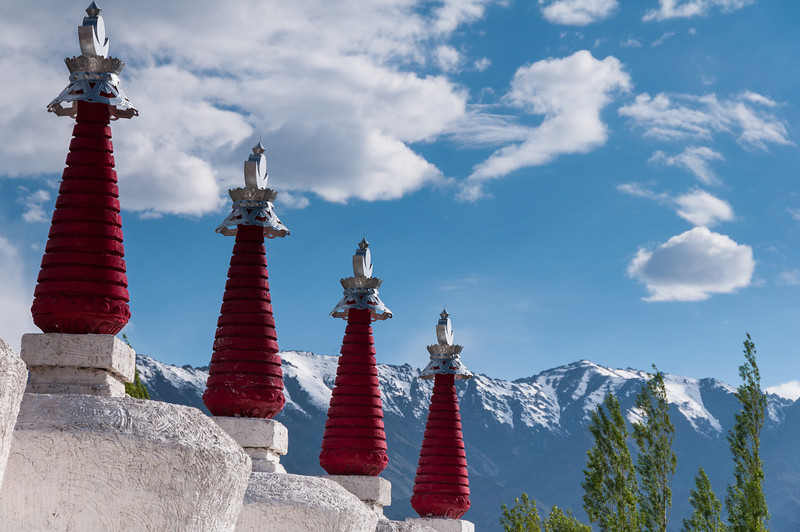 Four suns sit atop crescent moons overlooking the Zanskar Mountains. Thiksy Gompa, Ladakh
