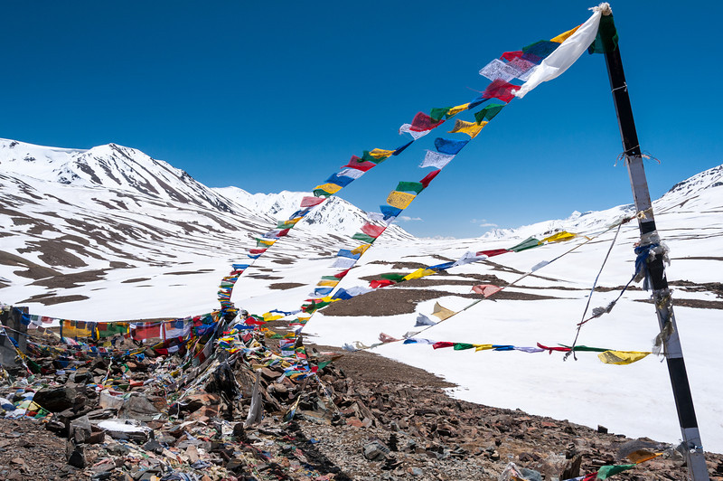 Prayer flags flutter in the wind of Baralacha La (4981m) on the Manali - Leh road