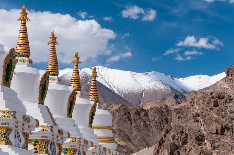 A row of Chortens overlook the Ladakh Range at Thiksey Gompa
