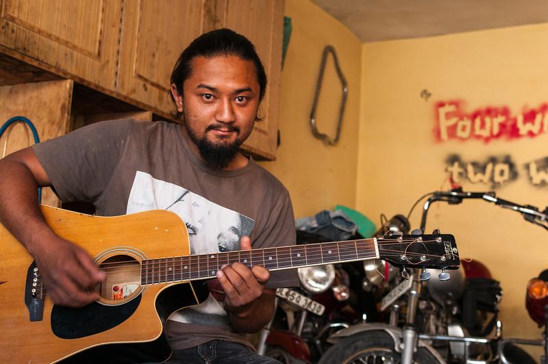 Tashi plays a tune as he awaits his next customer. Leh, Ladakh