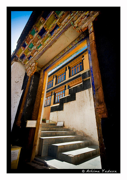 Entrance to Thiksey Monastery, Ladakh.<br /> <br /> Thiksey Monastery is the part of Gelukpa order in Buddhism and is beautifully located in the picturesque top of a hillock. It encloses numerous stupas, Thangkas, statues, swords, wonderful wall paintings and a large pillar carved with Buddha's ideas and preaching, all in a mammoth 12 storied building complex. A marvelous Buddha statue in the seated position is adorning the main prayer hall.
