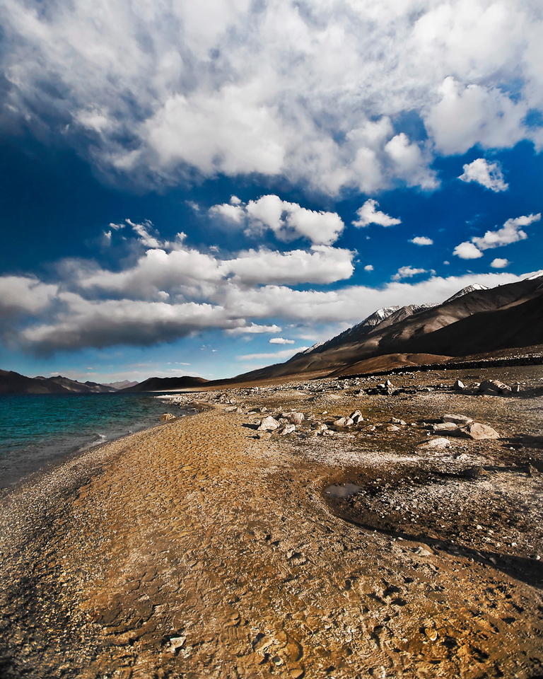 The Spectacular Lake Pangong Tso, Ladakh.<br /> <br /> At 13,900 ft and 83 miles length, Pangong Tso extends from India to China. During winter, the lake freezes completely, despite being saline water.