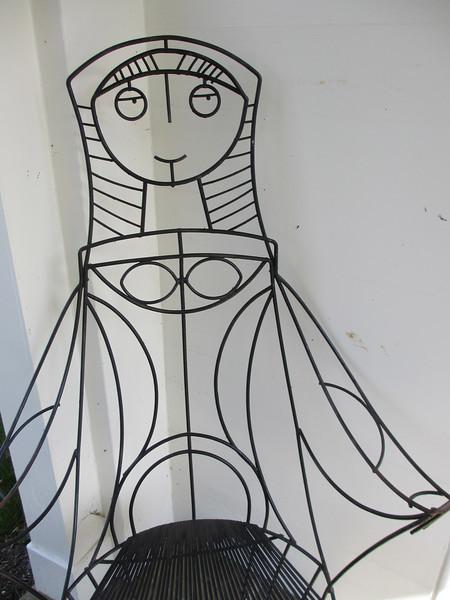Whimsical female chair back outside Ladew's home.