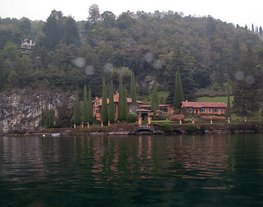 Sir Richard Branson's villa on the lake - someone was home as the fireplace was going and the lights were on. Then again while he is not there you can rent it for 20,000 Euro a week...