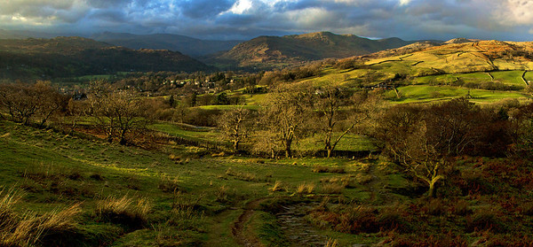 The picturesque town of Ambleside nestled among the hills at Sunset