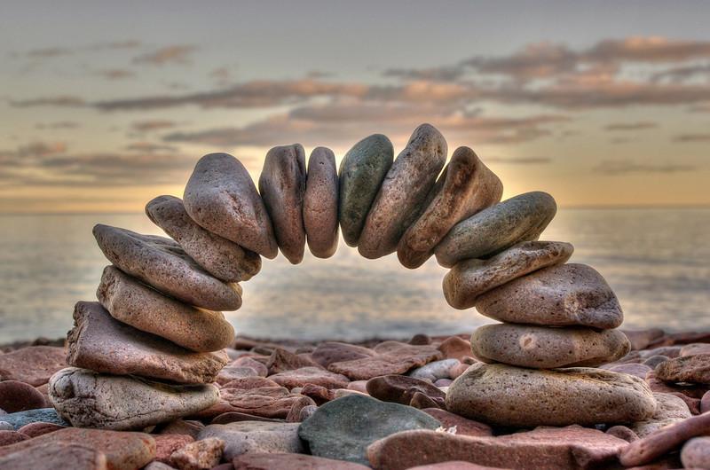Arch of small stones made by Rita on Kadunce beach, Lake Superior, Minnesota.