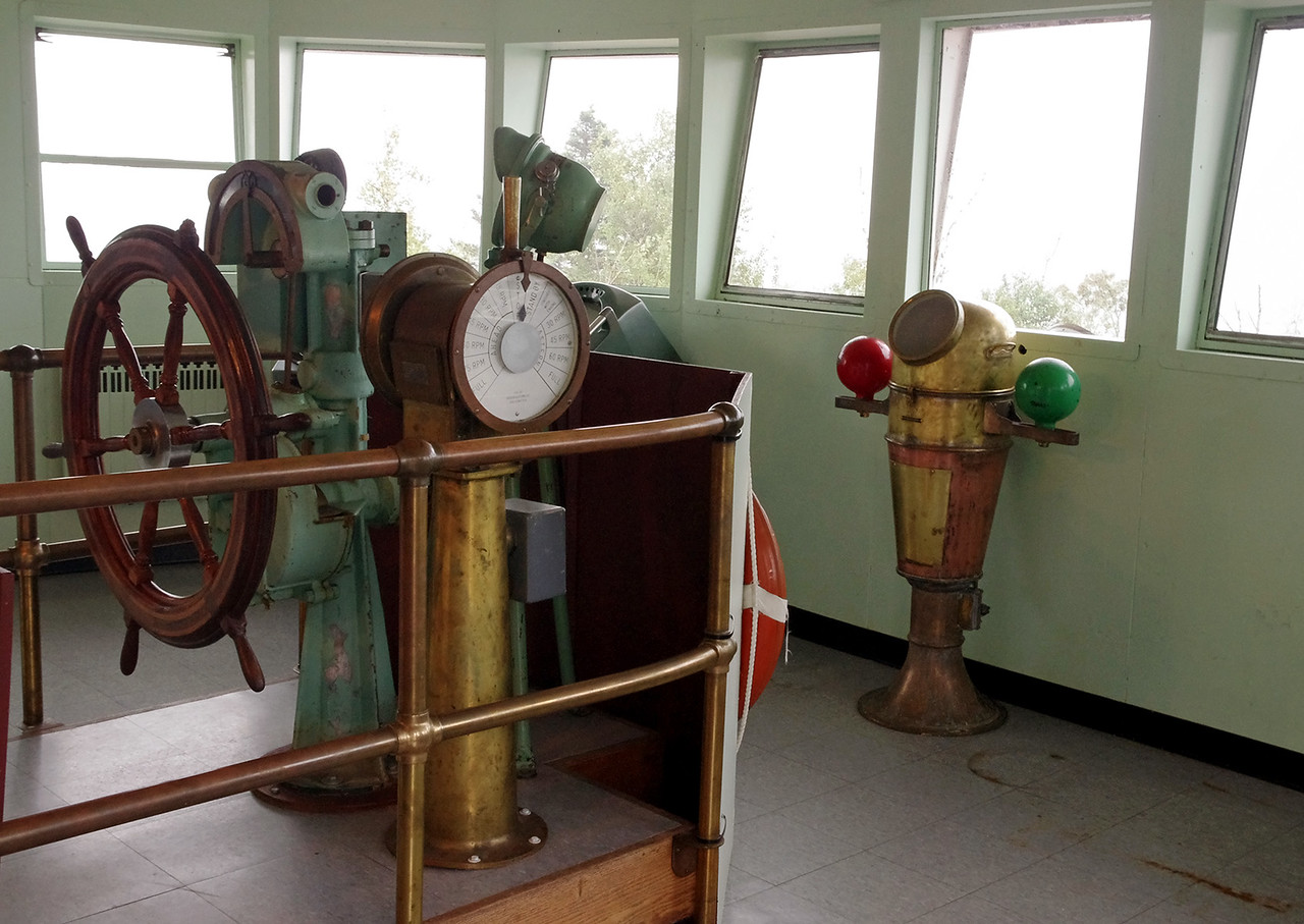 Wheel, ship's telegraph, and binnacle. Pilot house, Lighthouse Bed and Breakfast, Two Harbors, Minnesota.