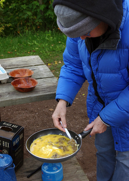 Rita's camp cooking. Temperance River State Park, Minnesota. Tonight's entre is a simple mushroom omelet.