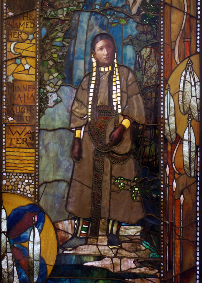 Tiffany stained glass window in the Duluth (Minnesota) Union Depot. The Minnehaha window depicts the legendary Native American princess Minnehaha, standing in front of Minnehaha Falls in Minneapolis, and was used in the 1893 Columbian Exposition in Chicago, as part of the Minnesota pavilion.