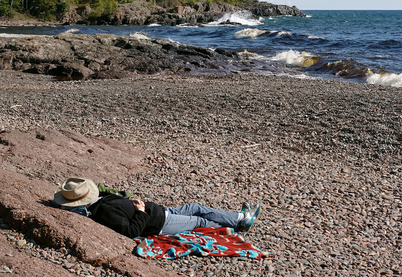 Rita napping on a pebble beach on the north shore of Lake Superior. Temperance River State Park, Minnesota.