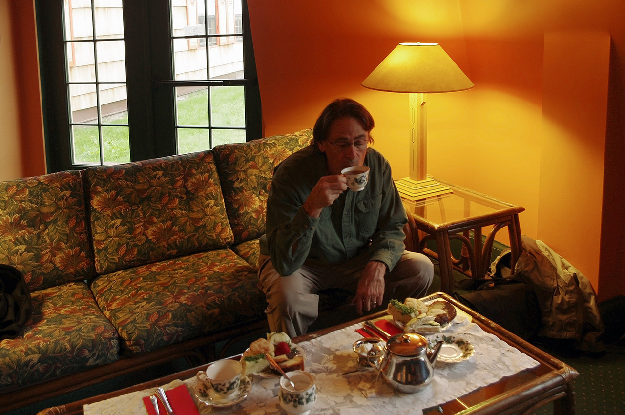 Gary sipping tea. Afternoon tea is served at the Naniboujou Lodge from 3-5 PM.