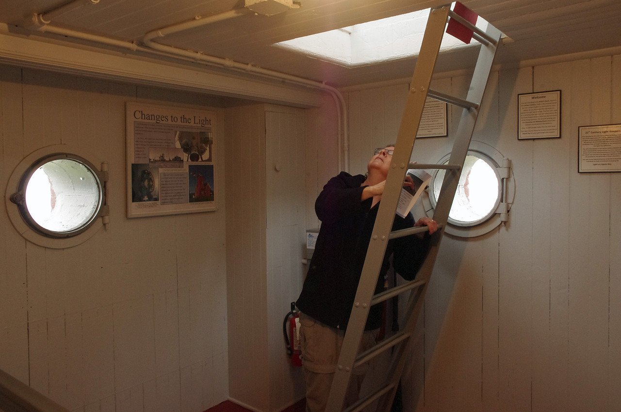 Rita explores the Pilot house at the Lighthouse Bed and Breakfast, Two Harbors, Minnesota.