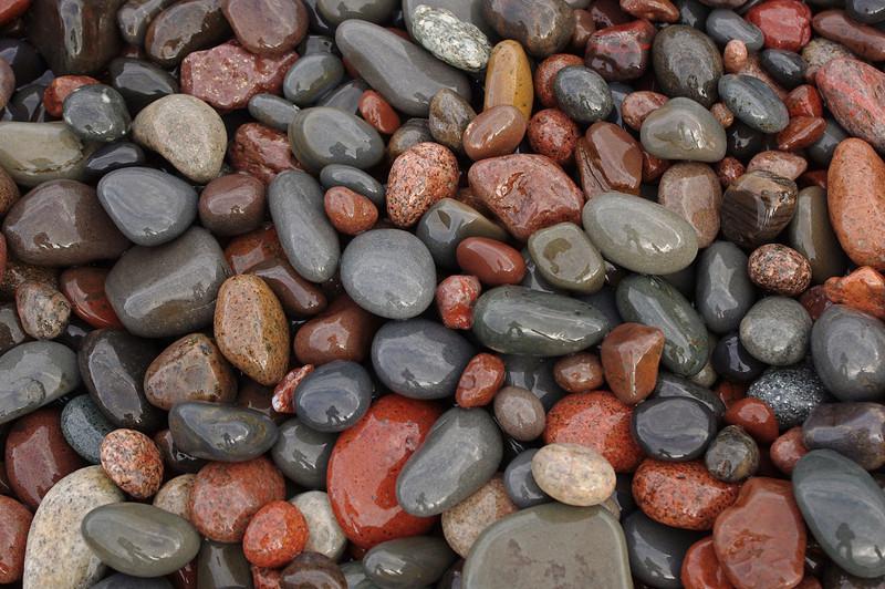 Wet beach pebbles. North shore of Lake Superior.